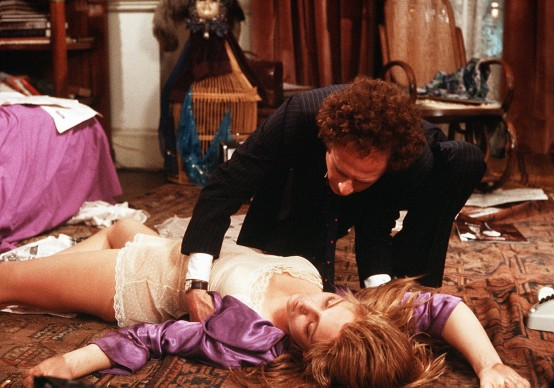 MILENA FLAHERTY (TERESA RUSSELL) LIES ON THE BED AFTER HER SUICIDE ATTEMPT AS ALEX LINDEN (ART GARFUNKEL) STRUGGLES WITH HER *** Local Caption *** Feature Film