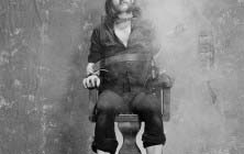 FILE: Motorhead Frontman Lemmy  Dies At 70 LONDON - 1st JULY: Lemmy Kilmister from Motorhead posed sitting strapped to an Electric Chair prop and smoking a cigarette during the photo session for the 'Killed By Death' single in Pimlico, London in July 1984. (Photo by Fin Costello/Redferns) ORG XMIT: 597734573